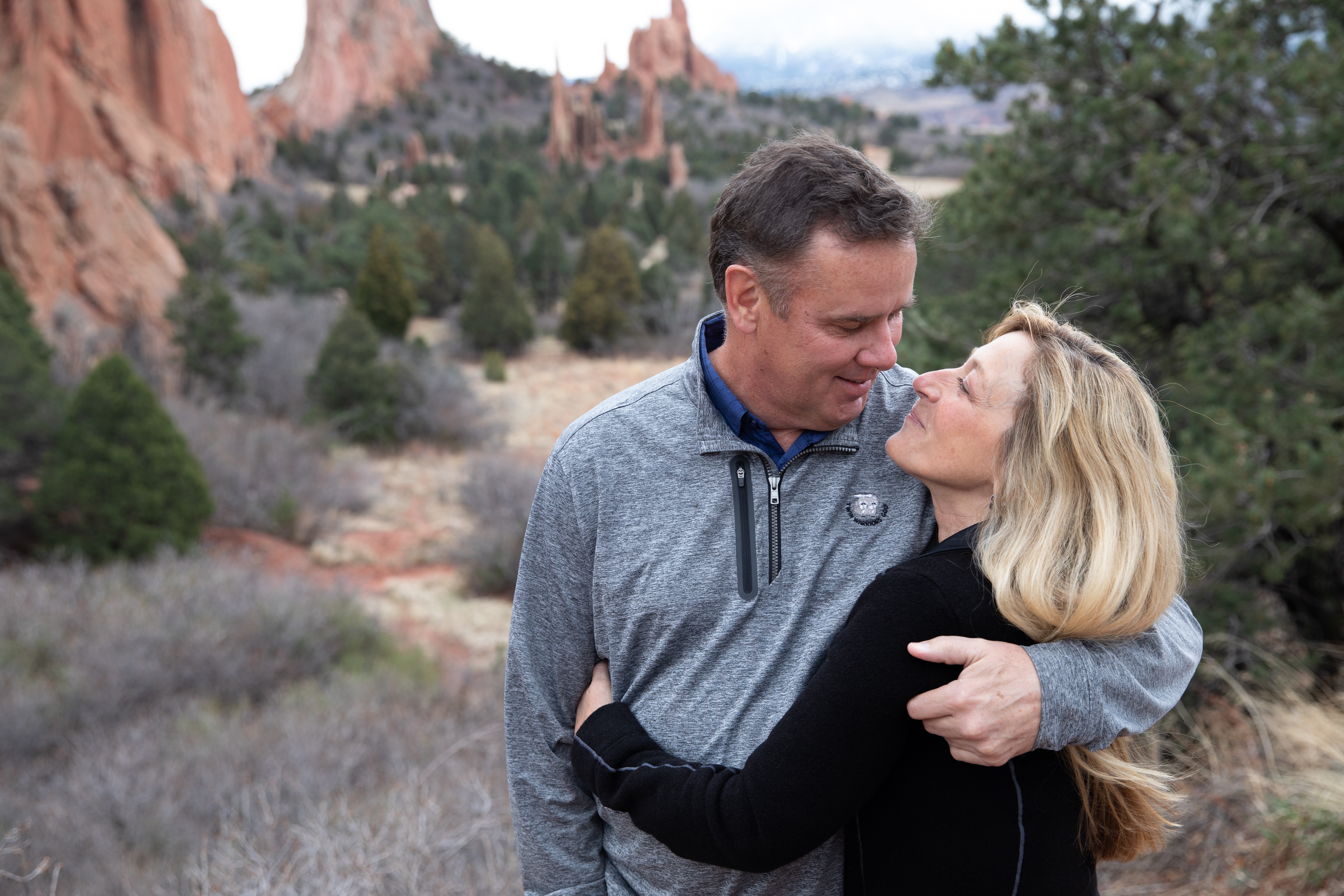 Portrait session picture of Shelley and Dan at the Garden of Gods with the rocks in background