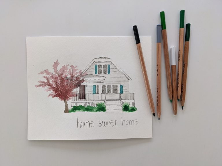 home watercolor painting and colored pencils on a white surface
