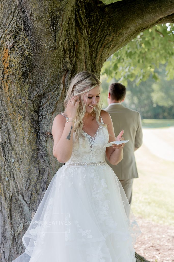 Bride and groom exchanging letters before a wedding ceremony
