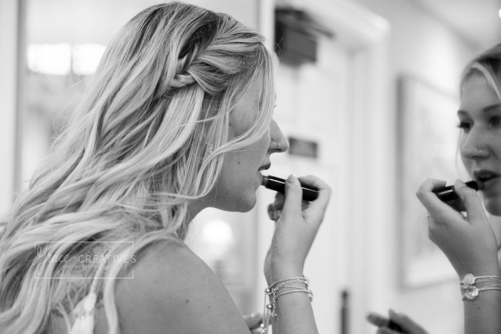 Wisconsin Bride applying lipstick