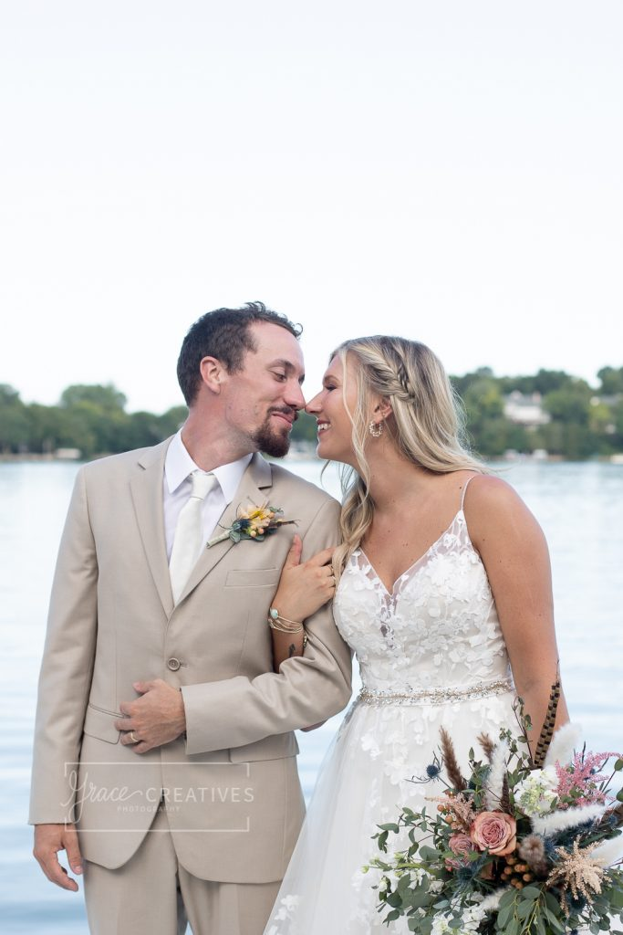 Bride and Groom photos on the dock at Chenequa country Club