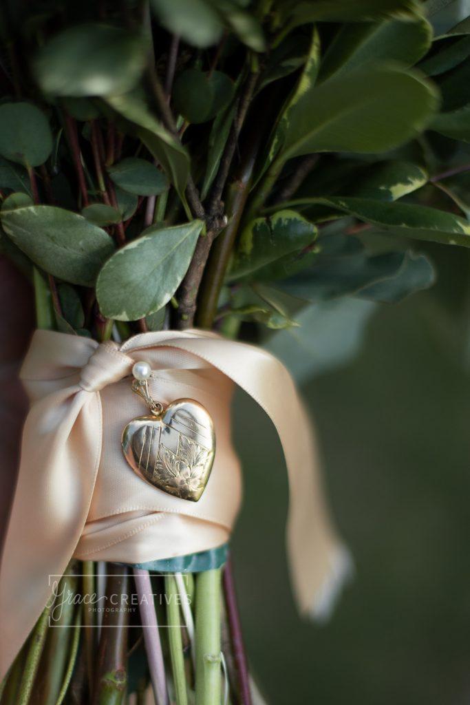 Locket wrapped around wedding flowers