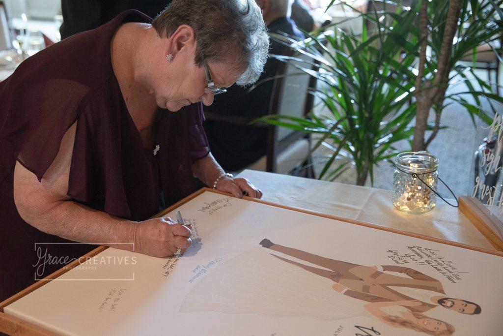 grandma signing a unique guest book illustration