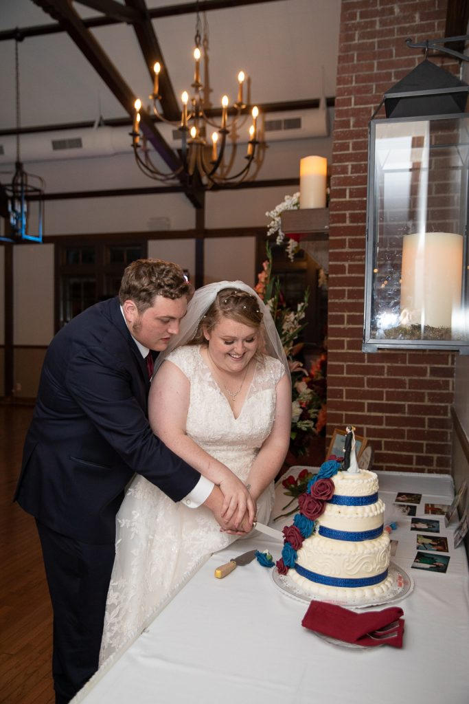 Bride and Groom Cutting cake at Meadowbrook Country Club Wedding