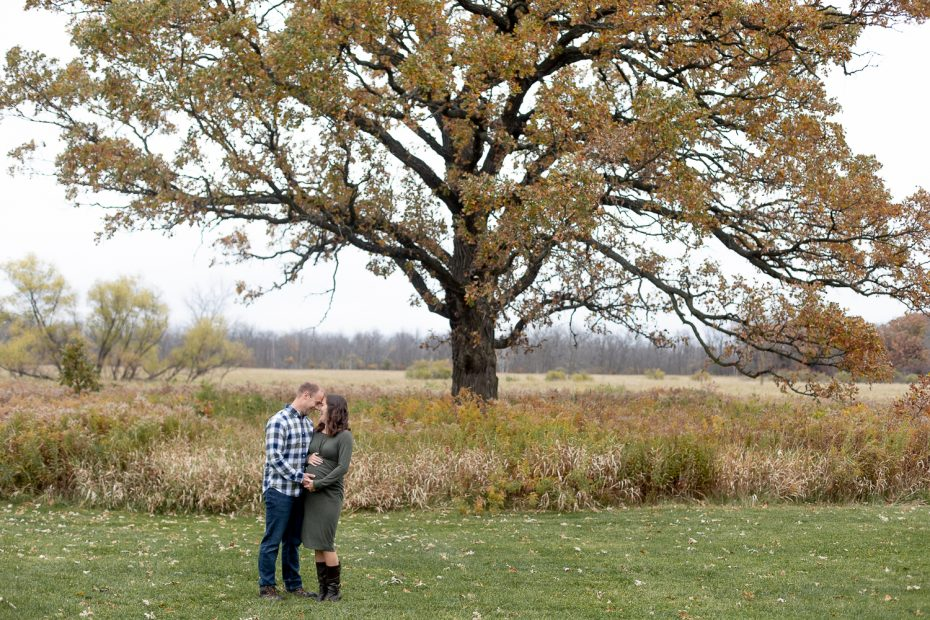 Photo of couple standing under tree at Fox Brook Park