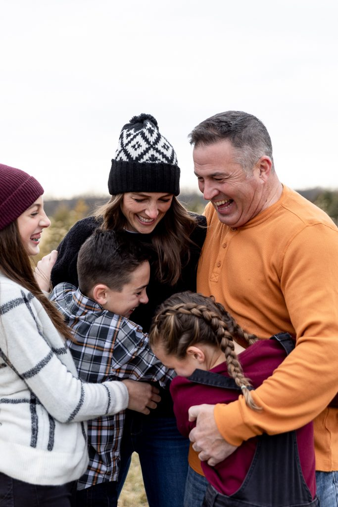 Family of five hugging during Milwaukee Christmas mini sessions