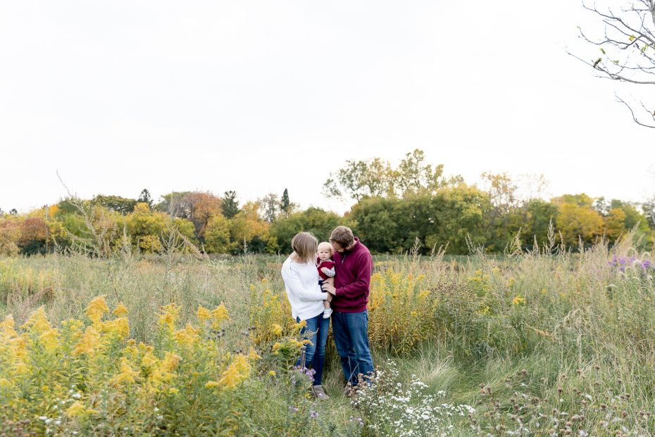 family of three standing in a field during fall 2020 mini sessions