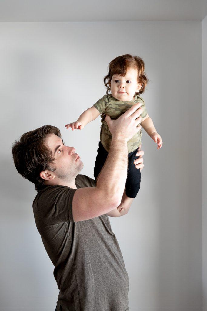 dad holding up son during Milwaukee milestone photos