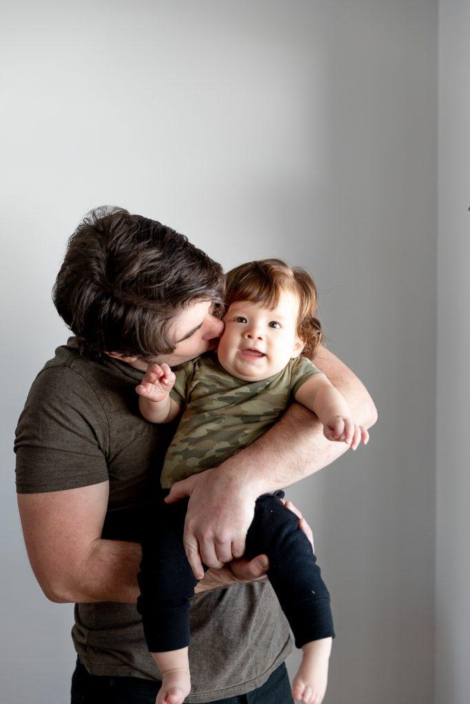 dad kissing son during Milwaukee milestone photos
