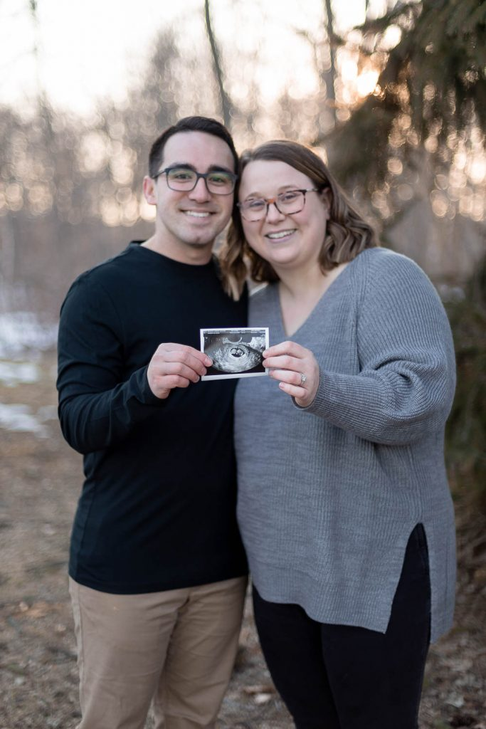 new mother and father during Hoyt Park Pregnancy Announcement