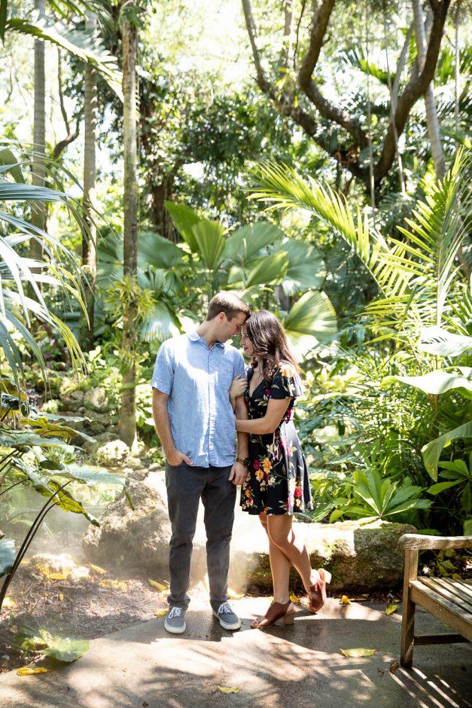 couple standing in the rainforest at Fairchild Botanical Gardens