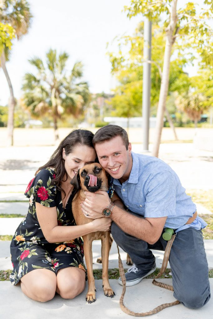 Couple with their adopted dog during engagement session with Grace Creatives
